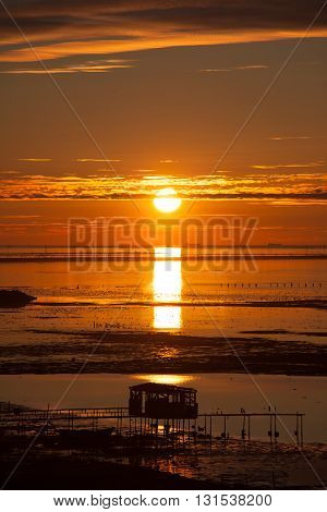 Sunset on the beach. Gold hours. Landscape on the beach, sitting down sun with heaven.