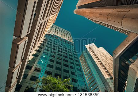 Upward view of Adelaide office buildings in CBD. Color-toning applied