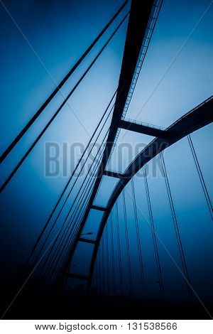 low angle view yangtse river bridge structure,chongqing china,blue toned image.