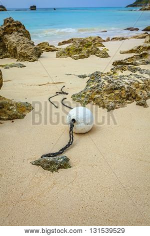 A buoy washed up on a Bermuda beach.
