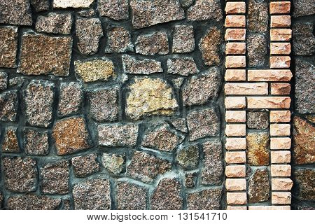 a gray and brown stone wall background