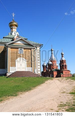 Old Russian abbey against blue sky at summer