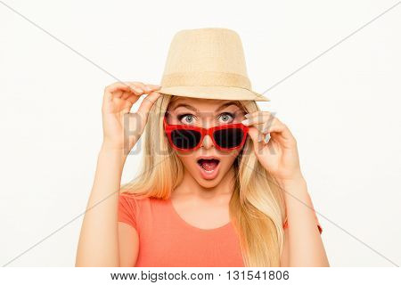 Surprised  Young Woman In Hat And Glasses With Open Mouth