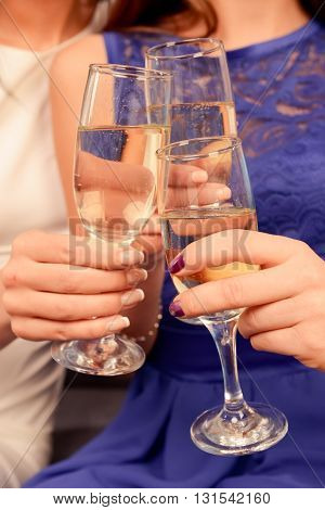 Close Up Of People Toasting At Celebration Clinking Their Glasses With Wine