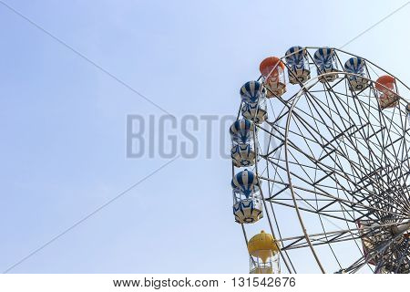 Brightly Colored Ferris Wheel On The Blue Sky