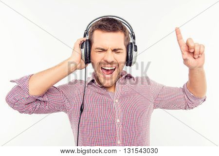 Cheerful Man In Headphones Listening Music And Gesturing With Fingers
