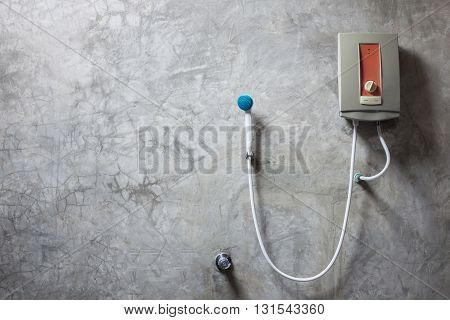 Water Heater On The Grey Cement Wall In Bathroom