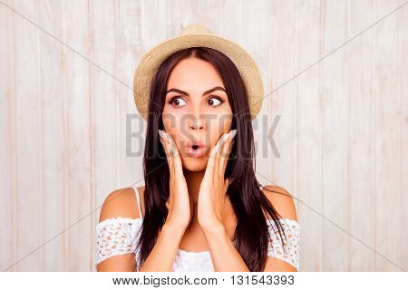 Portrait Of Shocked Woman In Summer Hat Touching Her Face