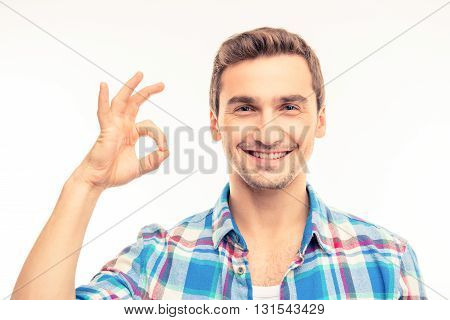 Portrait Of A Cute Handsome Young Man Gesturing Ok