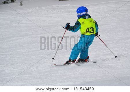 Child skiing - snowy landscape Hochficht in the Bohemian Forest