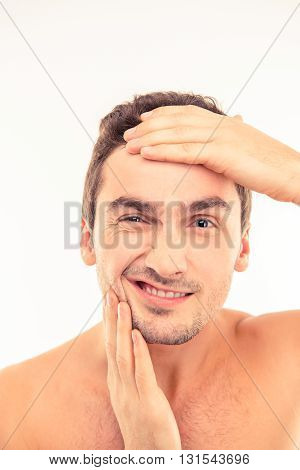 Handsome Funny Young Man Touching His Face