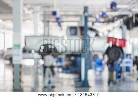 Blurred Background : Car Technician Repairing The Car In Garage