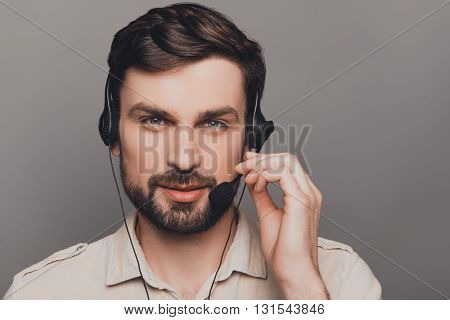 Portrait Of Young Happy Man In Head-phones Touching Microphone