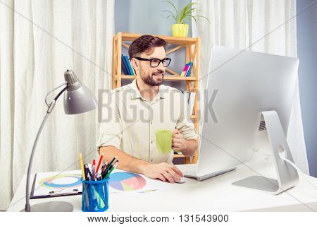 Handsome Businessman Working Hard And Drinking Coffee