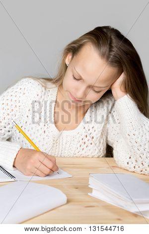 Schoolgirl Doing Difficult Homework