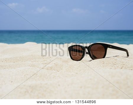 Sun glasses on Sand Beach Summer Holiday Travelling background
