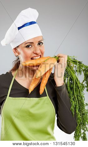 Woman Cook Biting Carrots