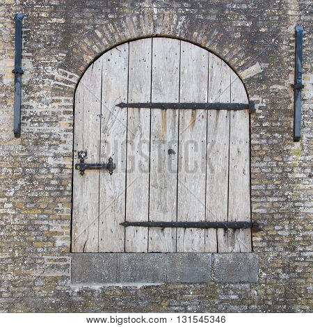 Old wooden door in a wall the Netherlands
