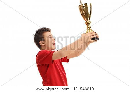 Joyful junior athlete lifting a trophy and celebrating isolated on white background