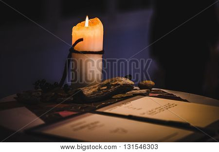 Reading a letter by candle light from old days