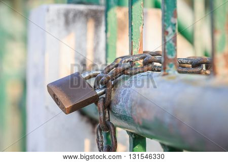 Close up lock and chain on steel fence