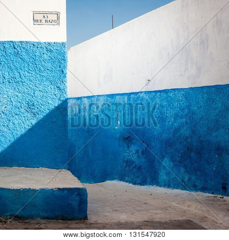 Traditional blue painted wall detail with geometric shadows, Rabat, Morocco