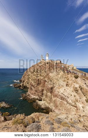 Cabo de Gata-Nijar, Spain - May 4, 2016: Large group of pupils visiting the lighthouse on the cliffs at Cabo de Gata-Nijar natural park