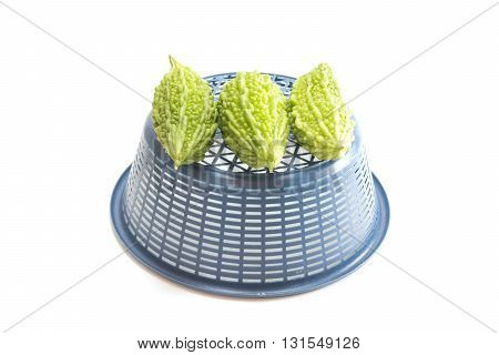 Bitter Melon Or Bitter Gourd With Bucket  On White Background