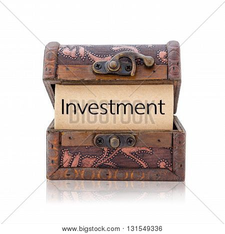 Investment word in treasure chest isolated on white background Save clipping path. Business concept.