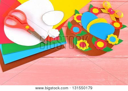Easy Easter craft idea for kids. Sheets of colored paper, scissors, paper patterns, Easter basket and eggs - set for children art