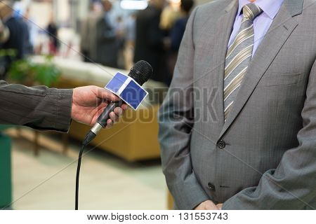 Journalist making interview with businessman or politician