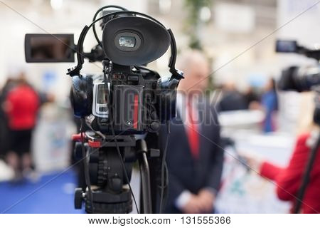 TV interview. Filming an event with a video camera.