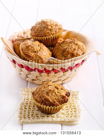 Carrot and raisin muffins on table selective focus