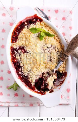 Berry crumble cake in a tin top view