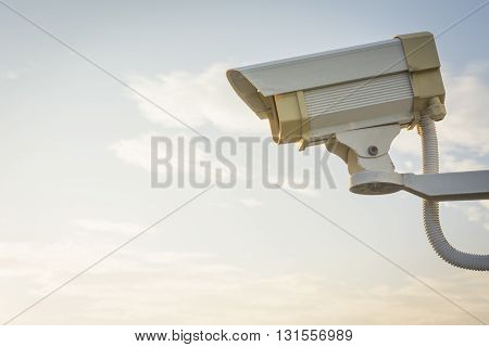 Cctv  Security Camera Video Surveillance On Sky Background