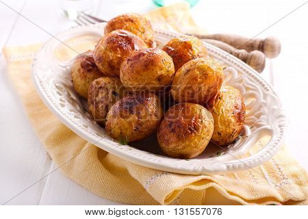 Roasted spicy new potatoes in a plate