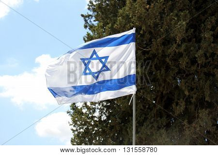 a strong wind waving flag of the State of Israel