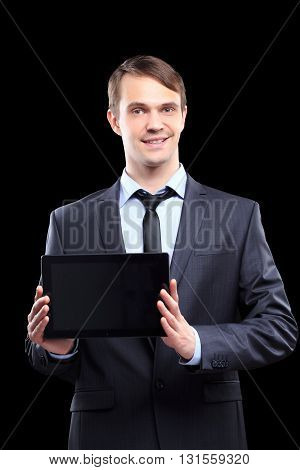 business man with tablet. business suit. Black background