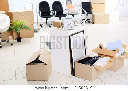 Move concept. Unpacking cardboard boxes in a new office