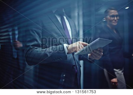 Businessman using touchpad at office