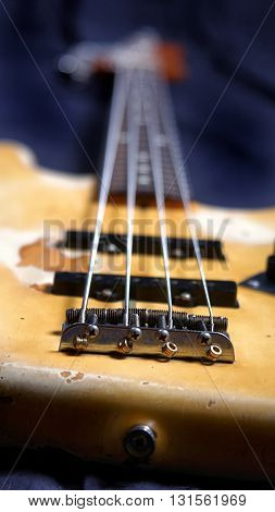 Old electric bass guitar focus forward, bass guitar