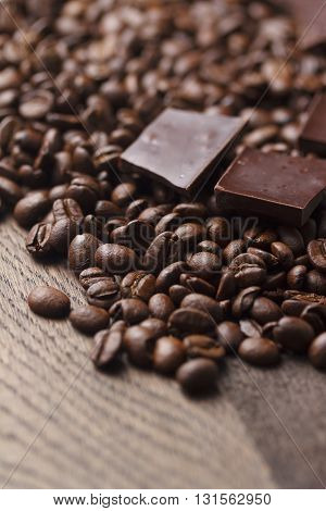 Coffee Beans With Chocolate On Wooden Background