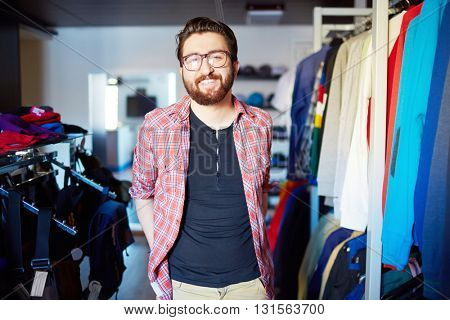 Portrait of male sales assistant in clothing store