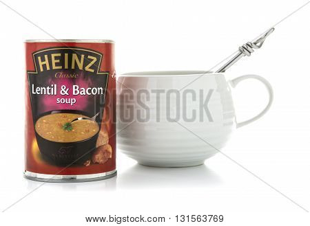 SWINDON UK - MAY 22 2016: Heinz lentil and Bacon soup with bowl and spoon on a white background