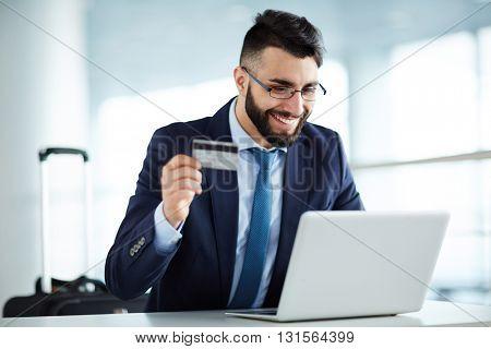 Businessman buying airline tickets online