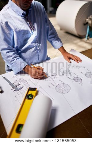 Mature engineer drawing technical details