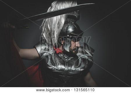 Empire, Praetorian Roman legionary and red cloak, armor and sword in war attitude