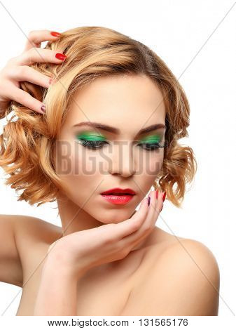 Beautiful girl with colorful makeup, manicure, isolated on white