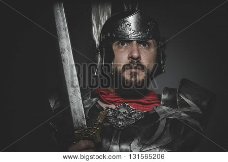 Spartan, Praetorian Roman legionary and red cloak, armor and sword in war attitude