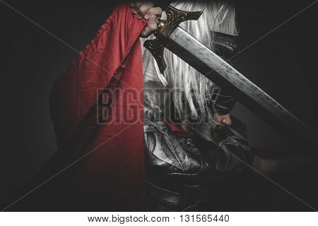 Armed, Praetorian Roman legionary and red cloak, armor and sword in war attitude